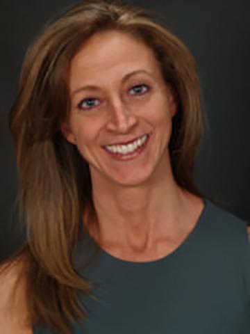 head shot photo of Arlene Bass smiling